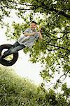 Boy Swinging on Tire Swing