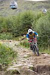 Man Mountain Biking on Bike Path, Aonach Mor, Scotland