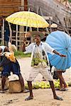 Boy with Umbrella at Village Market, Maroantsetra, Madagascar