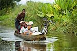 Men in Dugout Canoe, Antainambalana River, Maroantsetra, Madagascar