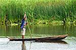 Boy in Dugout Canoe on River, Antainambala River, Maroantsetra, Madagascar
