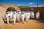 People in White Clothing Walking in Street, Soatanana, Madagascar