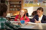 Portrait of Children Sitting at Desks in Classroom