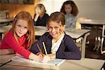 Portrait of Girls Sitting at Desks in Classroom