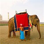 Young man standing in front of a mausoleum, Taj Mahal, Uttar Pradesh, India