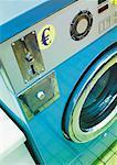 Symbole de l'euro sur la machine à laver public.