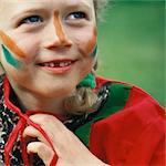 Little girl wearing war paint, close-up