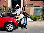 Couple Packing Car Full of Belongings