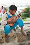 Portrait of Boy Playing Guitar, Antananarivo, Madagascar