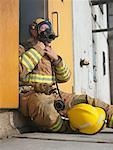 Firefighter in Doorway of Smoke-filled Building