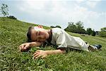 Boy Lying Down on Grass