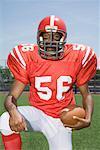 Football player posing with ball