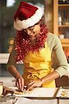 Woman in Santa Hat Making Cookies
