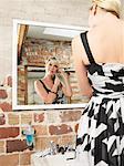 Woman in Bathroom Getting Ready