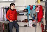 Man Looking at Messy Half of Closet