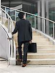 Man Ascending Staircase