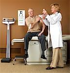 Doctor Giving Patient Needle