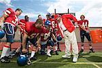 Verser l'eau sur l'entraîneur des joueurs de football