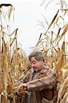 Farmer Checking Corn