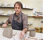 Portrait of Man in Pottery Studio