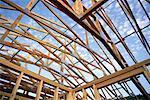 wood frame house against blue sky