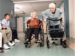 Senior Women Racing in Hospital Hallway