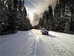 Car Driving on Snowy Road, Banff, Alberta, Canada
