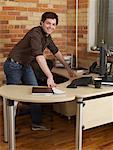 Businessman Standing Behind Desk