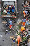 Garbage Men Cleaning Street