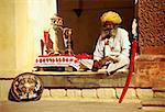 Senior man sitting at a veranda of a museum, Meherangarh Museum, Jodhpur, Rajasthan, India