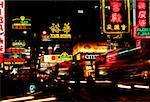 Neon signboards lit up at night, Kowloon, Hong Kong, China
