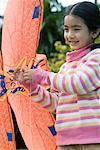 Girl holding kite