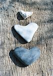 Heart-shaped stones on wood
