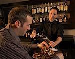 Bartender Serving Beer to Customer
