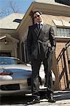 Businessman in Driveway