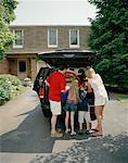 Family Packing Minivan