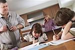 Father Watching Children do Homework