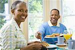 Close-up of a senior man and a senior woman having breakfast