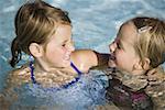Two girls in swimming pool