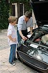 Father Teaching Son Mechanics