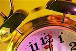 Closeup of alarm clock just after midnight