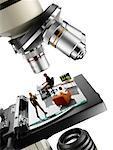 Miniature People on Microscope