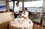 Waiter handing a man the menu in a restaurant