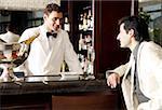 Man sitting at a bar talking to the bartender
