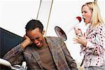 Woman Using Megaphone to Talk to Man