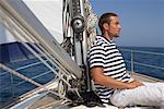 Man sitting on a sailing yacht