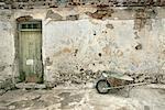 Wheelbarrow Near Plastered Wall