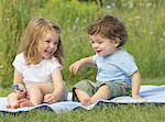 Children Sitting Outdoors