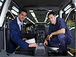 Two Men Inspecting Car