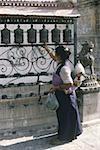 Nepal, Swayambhunath, woman turning prayer wheel